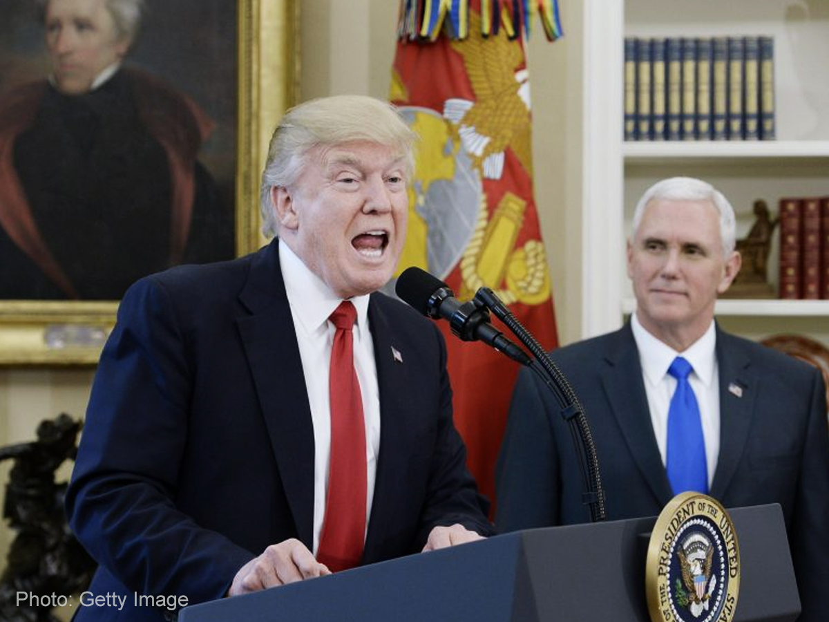 Trump leaves executive orders unsigned, walks out on reporters