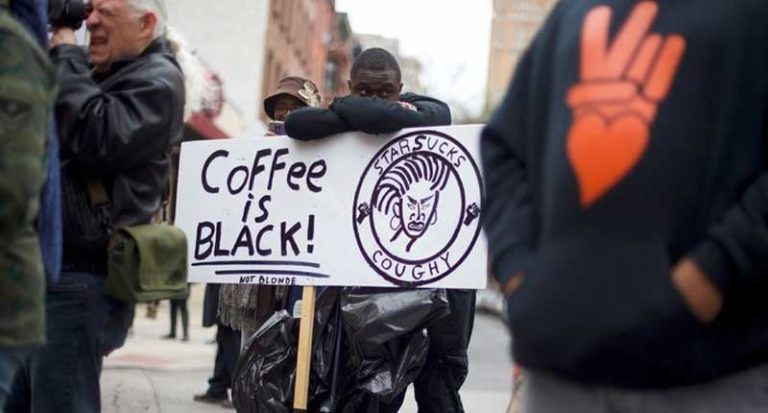 A protester demonstrated on Sunday outside a Starbucks in Philadelphia
